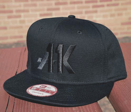 AK11 black-on-black snapback from the right