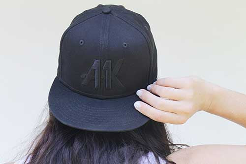 ali wearing the ak11 snapback backward
