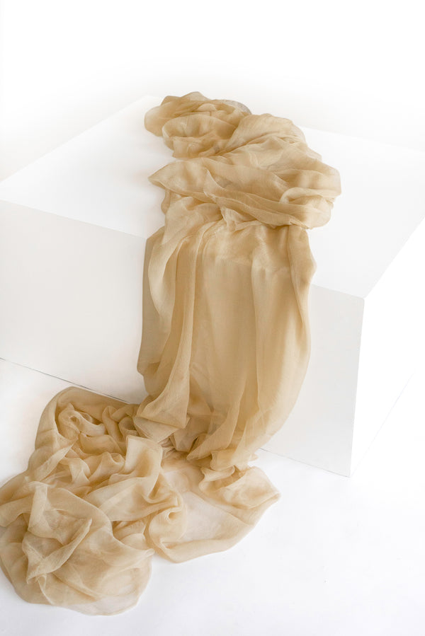 Tono + co Gossamer Silk Textile in Cream. Perfect for styling, tabletop design, detail work, or as a table runner. Find your inspiration through color and silk. Lovingly hand-dyed in Santa Ana, California and available in 24 signature colors. Check out our website for more styling, flat-lay, and color tips.