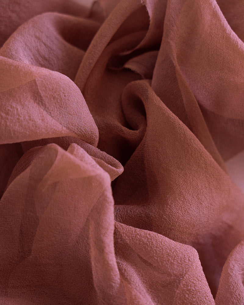Tono + co Gossamer Silk Textile in Copper. Perfect for styling, tabletop design, detail work, or as a table runner. Find your inspiration through color and silk. Lovingly hand-dyed in Santa Ana, California and available in 24 signature colors. Check out our website for more styling, flat-lay, and color tips.