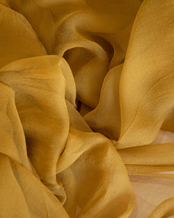 Tono + co Gossamer Silk Textile in Oro. Perfect for styling, tabletop design, detail work, or as a table runner. Find your inspiration through color and silk. Lovingly hand-dyed in Santa Ana, California and available in 24 signature colors. Check out our website for more styling, flat-lay, and color tips.