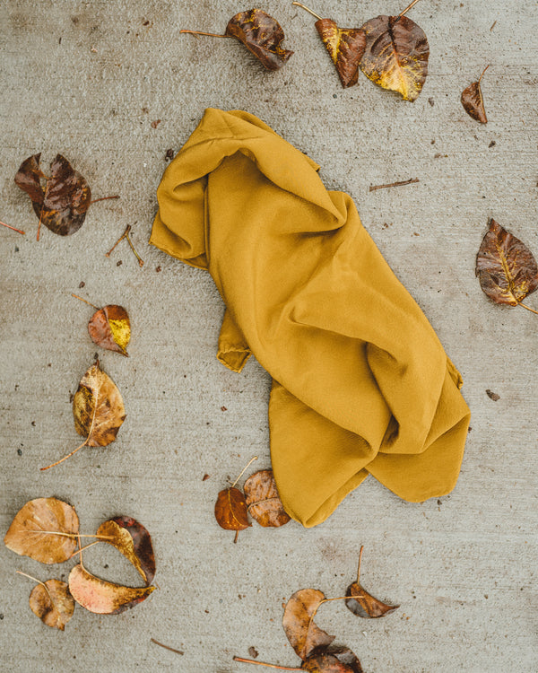 Tono + co Scout Silk Scarf in Oro. Lovingly hand-dyed in Santa Ana, California and available in 24 signature colors. Styled by Erica Kopp of Stay Co and photographed by Tess Comrie for our Fall 2018 Lookbook. Check out our website for more style and color inspiration.