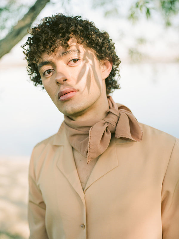 Tono + co Scout Silk Scarf in Rose Gold. Lovingly hand-dyed in Santa Ana, California and available in 24 signature colors. Styled by Erica Kopp of Stay Co and photographed by Tess Comrie for our Summer 2019 Lookbook. Check out our website for more style and color inspiration.