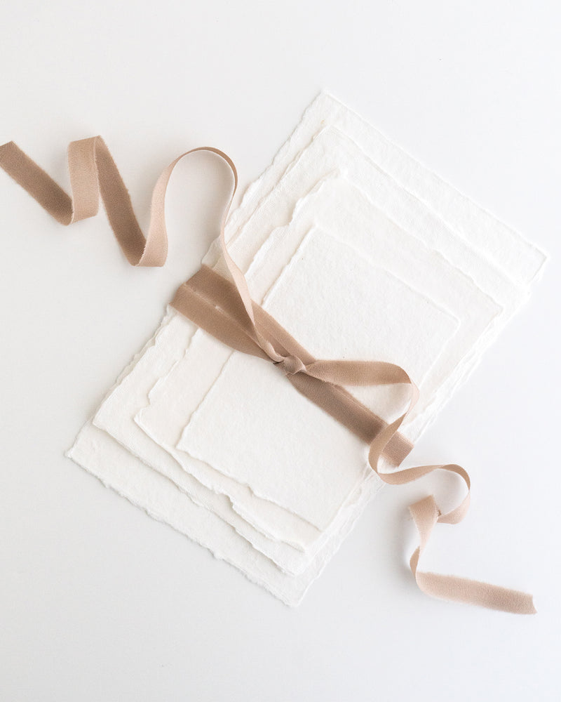Tono + co Silk Ribbon Trim in Fawn. Perfect for stationary styling, boutonnieres, and detail work. Find your inspiration through color and silk. Lovingly hand-dyed in Santa Ana, California and available in 24 signature colors. Check out our website for more styling, flat-lay, and color tips.