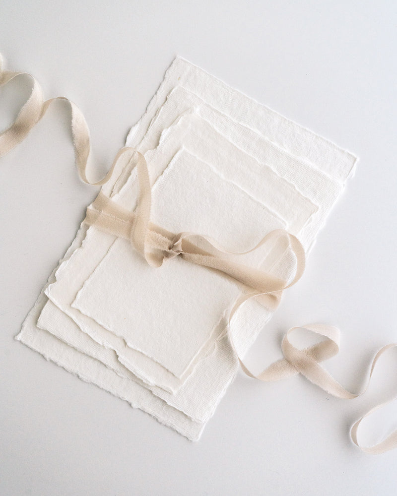 Tono + co Silk Ribbon Trim in Bone. Perfect for stationary styling, boutonnieres, and detail work. Find your inspiration through color and silk. Lovingly hand-dyed in Santa Ana, California and available in 24 signature colors. Check out our website for more styling, flat-lay, and color tips.