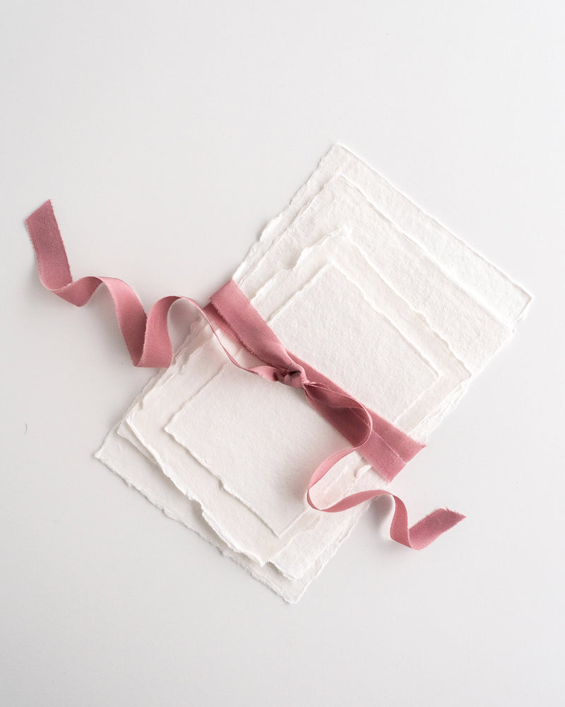 Tono + co Silk Ribbon Trim in Rose. Perfect for stationary styling, boutonnieres, and detail work. Find your inspiration through color and silk. Lovingly hand-dyed in Santa Ana, California and available in 24 signature colors. Check out our website for more styling, flat-lay, and color tips.