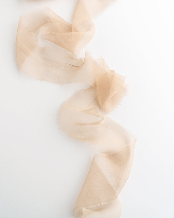 Tono + co Gossamer Silk Ribbon in Limited Edition Sand. Perfect for stationary styling, florals, and detail work. Find your inspiration through color and silk. Lovingly hand-dyed in Santa Ana, California and available in 24 signature colors. Check out our website for more styling, flat-lay, and color tips.