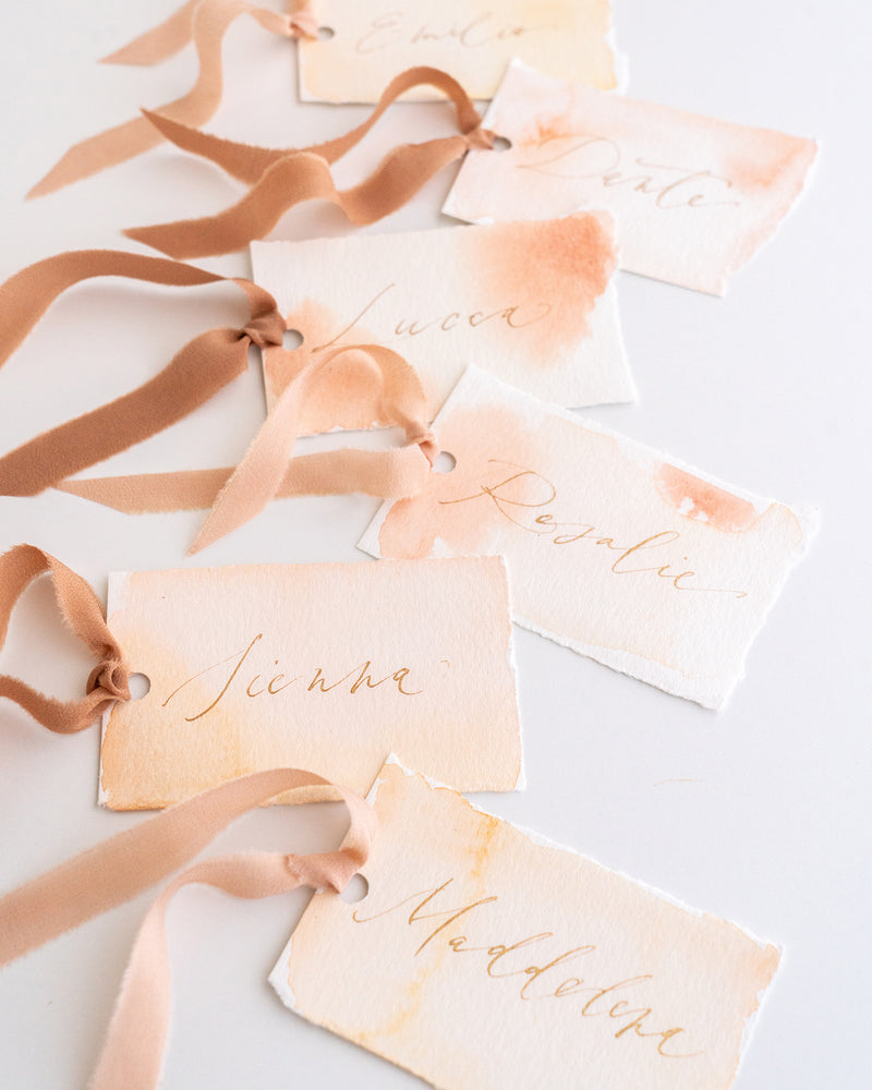 Tono + co Silk Ribbon Trim in Peach and Rose Gold. Perfect for stationary styling, boutonnieres, and detail work. Find your inspiration through color and silk. Lovingly hand-dyed in Santa Ana, California and available in 24 signature colors. Check out our website for more styling, flat-lay, and color tips.