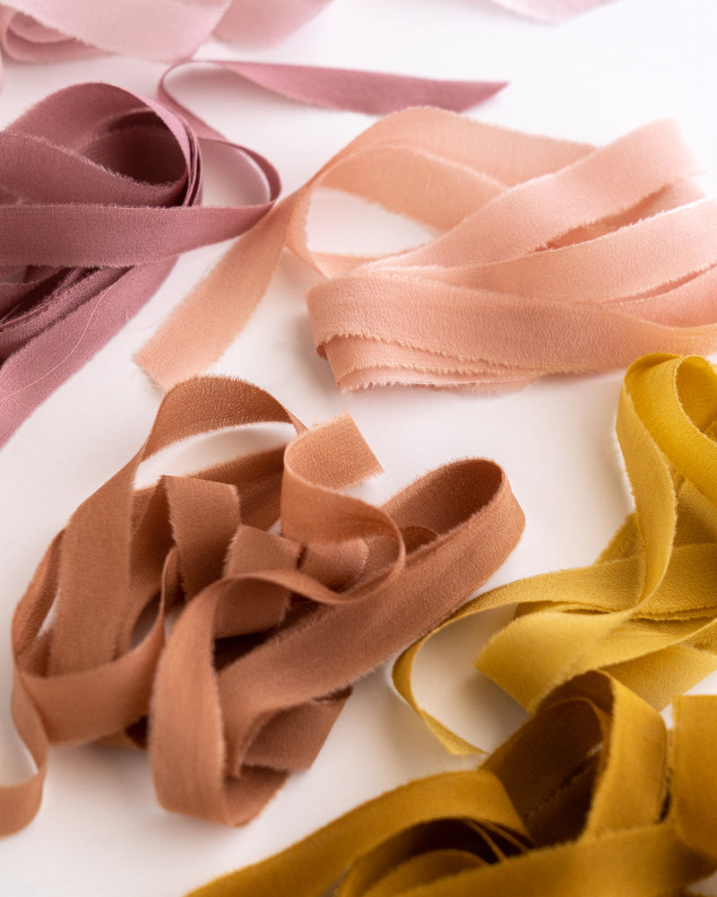 Tono + co Silk Ribbon Trim, featuring favorites from the Rouge + Earth + Golden Collections. Perfect for stationary styling, boutonnieres, and detail work. Lovingly hand-dyed in Santa Ana, California and available in 24 signature colors. Check out our website for more styling, flat-lay, and color inspiration.