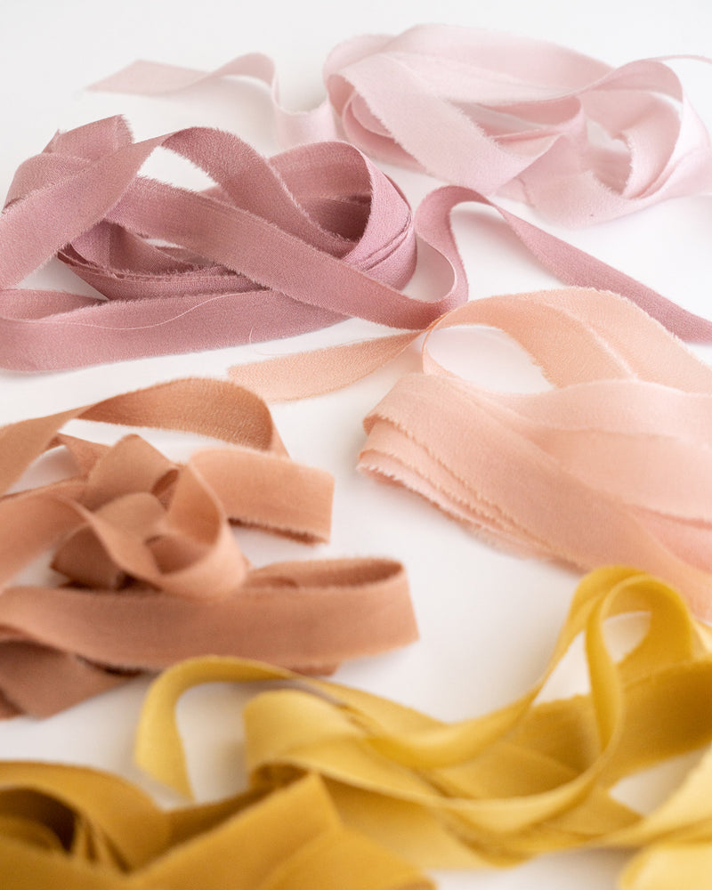 Tono + co Silk Ribbon Trim, featuring favorites from the Rouge + Earth + Golden Collections. Perfect for stationary styling, boutonnieres, and detail work. Find your inspiration through color and silk. Lovingly hand-dyed in Santa Ana, California and available in 24 signature colors. Check out our website for more styling, flat-lay, and color tips.