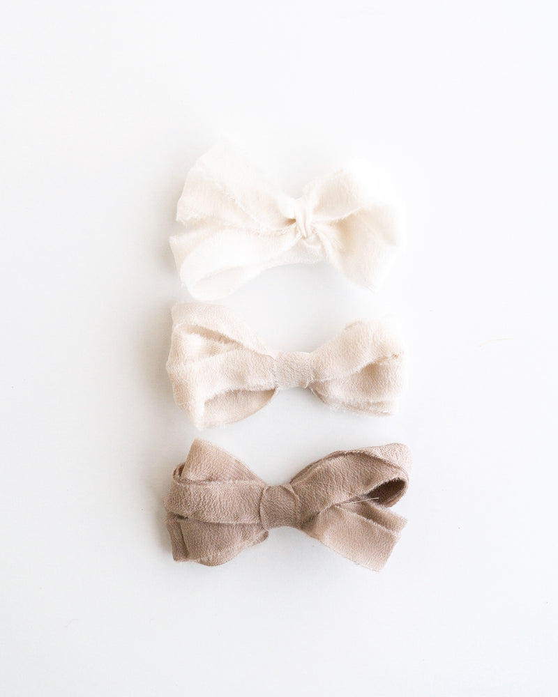 Tono + co Silk Ribbon Trim in The Natural Collection. Perfect for stationary styling, boutonnieres, and detail work. Find your inspiration through color and silk. Lovingly hand-dyed in Santa Ana, California and available in 24 signature colors. Check out our website for more styling, flat-lay, and color tips.