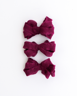 Tono + co Silk Ribbon Trim in Berry. Perfect for stationary styling, boutonnieres, and detail work. Find your inspiration through color and silk. Lovingly hand-dyed in Santa Ana, California and available in 24 signature colors. Check out our website for more styling, flat-lay, and color tips.