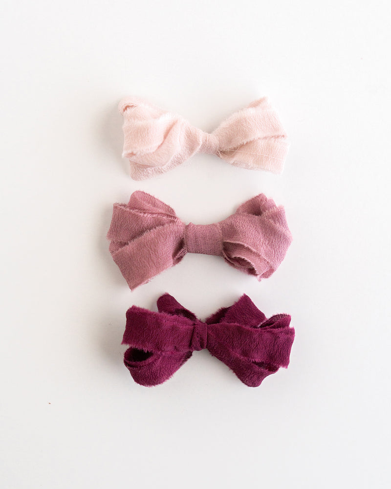 Tono + co Silk Ribbon Trim in the Rouge Collection. Perfect for stationary styling, boutonnieres, and detail work. Find your inspiration through color and silk. Lovingly hand-dyed in Santa Ana, California and available in 24 signature colors. Check out our website for more styling, flat-lay, and color tips.