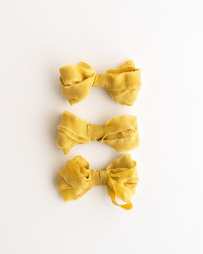 Tono + co Silk Ribbon Trim in Honey. Perfect for stationary styling, boutonnieres, and detail work. Find your inspiration through color and silk. Lovingly hand-dyed in Santa Ana, California and available in 24 signature colors. Check out our website for more styling, flat-lay, and color tips.