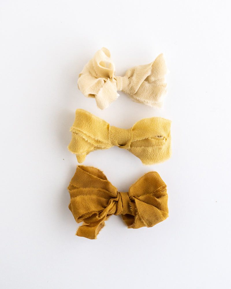Tono + co Silk Ribbon Trim in the Golden Collection. Perfect for stationary styling, boutonnieres, and detail work. Find your inspiration through color and silk. Lovingly hand-dyed in Santa Ana, California and available in 24 signature colors. Check out our website for more styling, flat-lay, and color tips.