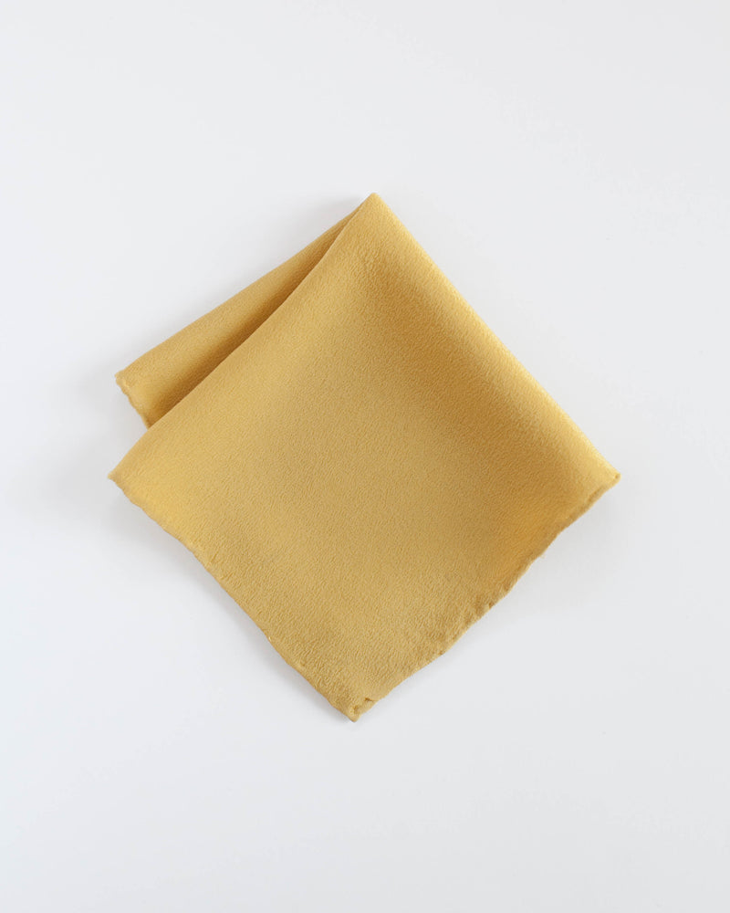 Tono + co Silk Hankie in Honey. Lovingly hand-dyed in Santa Ana, California and available in 24 signature colors. Check out our website for more style, color, and everyday wear inspiration.