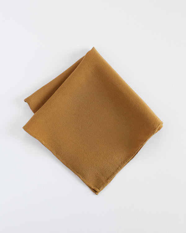 The Tono + co Silk Hankie in Oro is the perfect everyday accessory. Versatile and functional, it can be used as a pocket square, napkin, bandana, or a traditional hankie. Lovingly hand-dyed in Santa Ana, California and available in 24 signature colors. Check our our website for more color, styling, and lookbook inspiration.