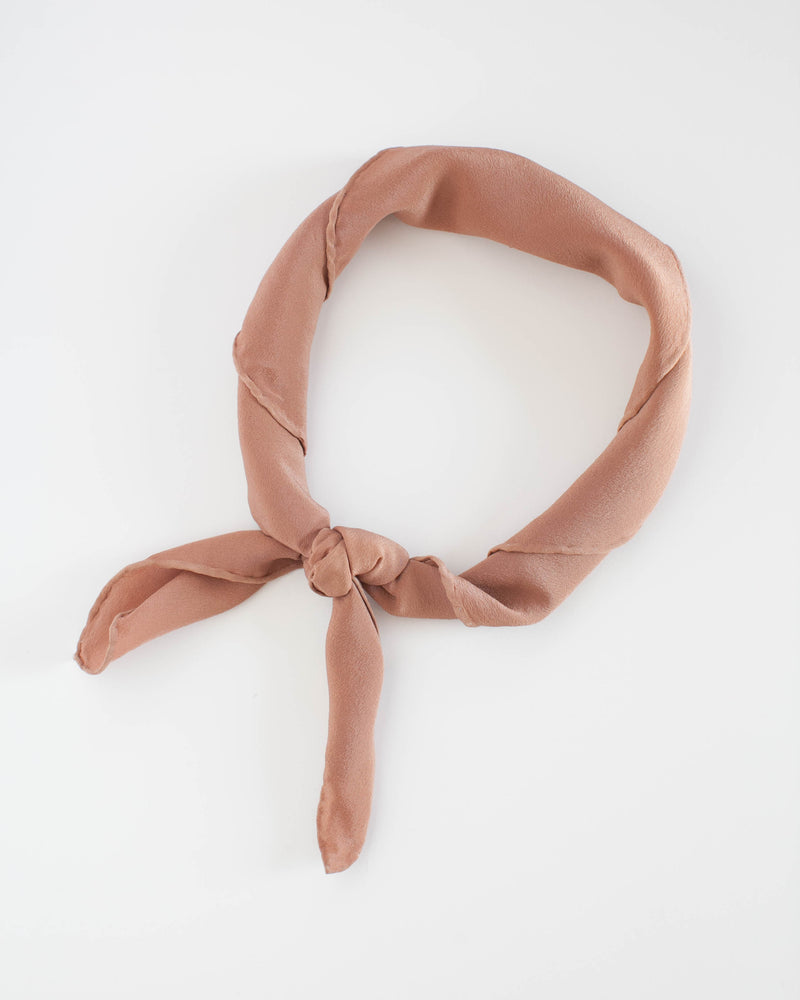 Tono + co Scout Silk Scarf in Rose Gold. Lovingly hand-dyed in Santa Ana, California and available in 24 signature colors. Check out our website for more style and color inspiration.