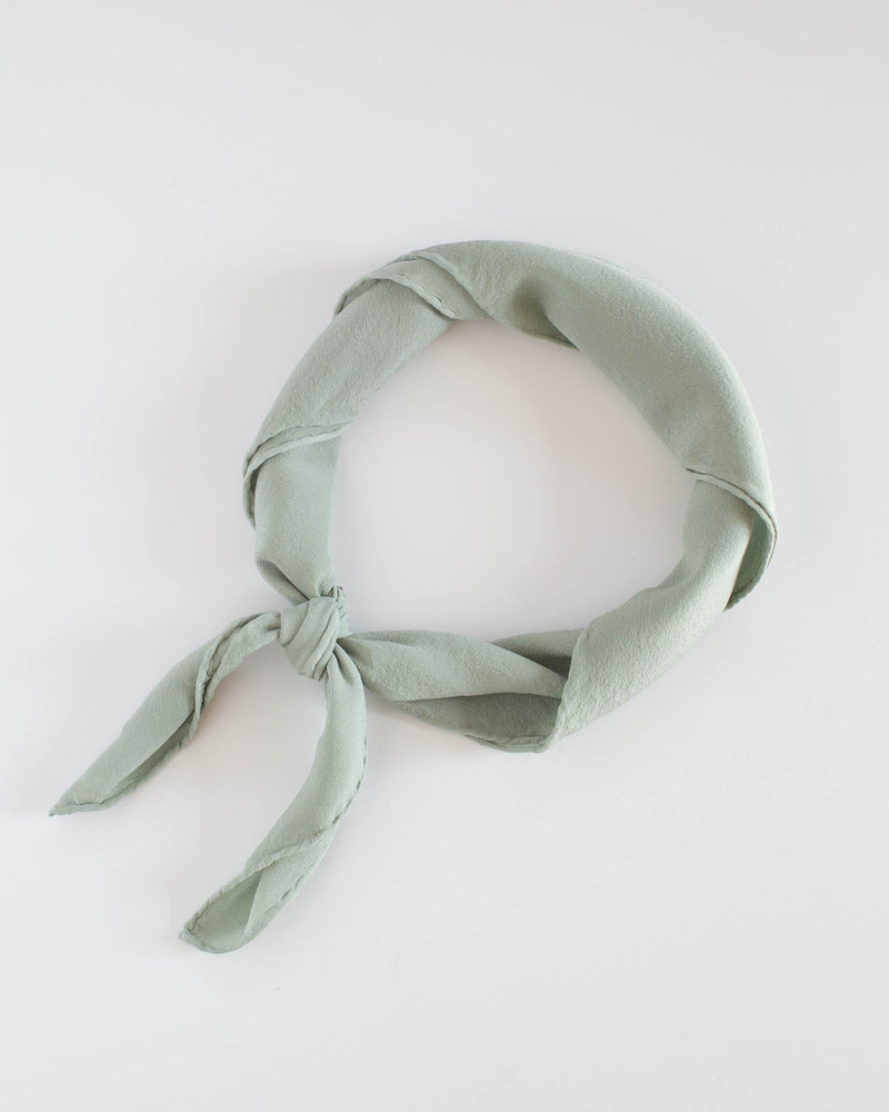 Tono + co Scout Silk Scarf in Sage. Lovingly hand-dyed in Santa Ana, California and available in 24 signature colors. Check out our website for more style, fashion, and lookbook inspiration.