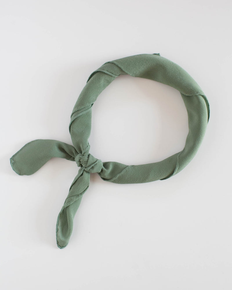 Tono + co Scout Silk Scarf in Fern. Lovingly hand-dyed in Santa Ana California and available in 24 signature colors. Check out our website for more style, color, and fashion inspiration.