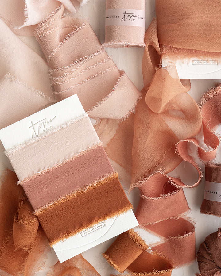 Tono + co Limited Edition 'The Color Orange' in Classic Silk Ribbon. View the new fall favorites featuring Champagne + Terra Cotta + Rust, lovingly hand-dyed in Santa Ana, California. Check out our website for more color, wedding, and styling inspiration.