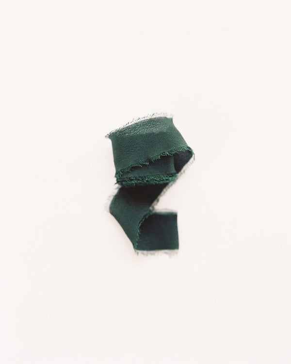 Tono + co Classic Silk Ribbon in Moss. Lovingly hand-dyed in Santa Ana, California and available in 24 signature colors. Check out our website for more color, styling, and bridal inspiration.