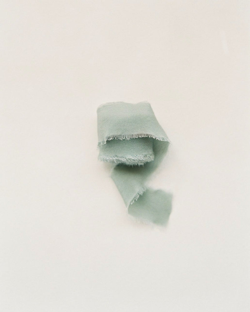 Tono + co Classic Silk Ribbon in Sage. Lovingly hand-dyed in Santa Ana, California and available in 24 signature colors. Check out our website for more color, styling, and bridal inspiration.