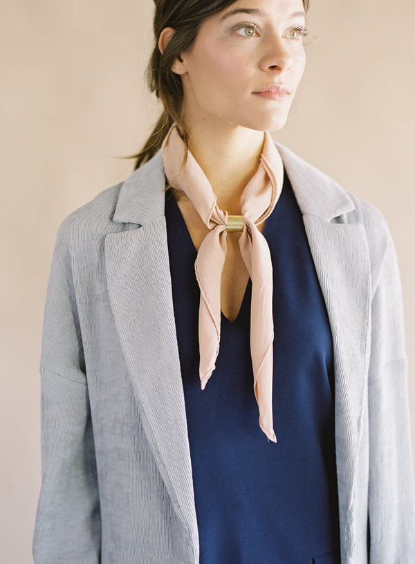 Tono + co Scout Silk Scarf in Peach. The perfect accessory for everyday styling. Lovingly hand-dyed in Santa Ana, California and available in 24 signature colors.