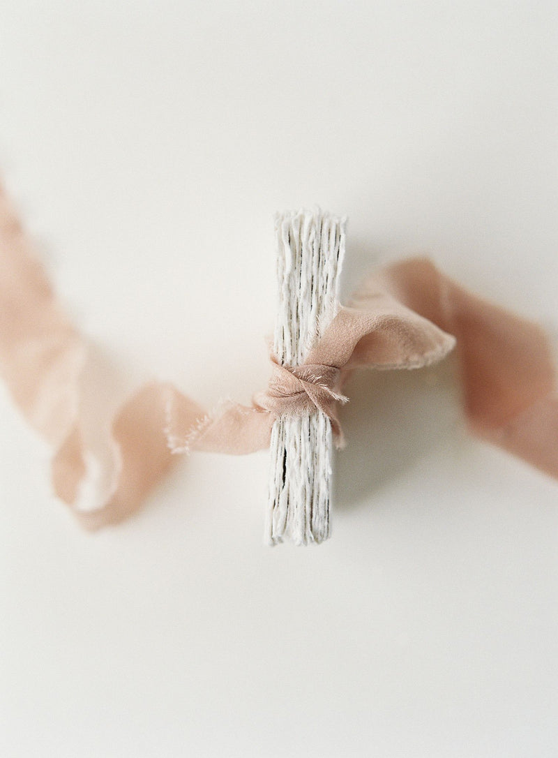 Tono + co Classic Silk Ribbon in Peach, perfect for stationary, flat-lay, and everyday styling. Find your inspiration through color and silk. Lovingly hand-dyed in Santa Ana, California and available in 24 signature colors.