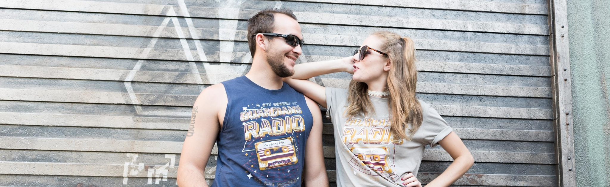"Donna and Cody of Brand By You outside Guardians of the Galaxy: Mission Breakout at the Tivan Wall sporting their ""Guardians Radio"" tees - designed and printed for and by Brand By You. We hope to be your destination for fun, clever, and unique park day apparel that has a Disney flare!"