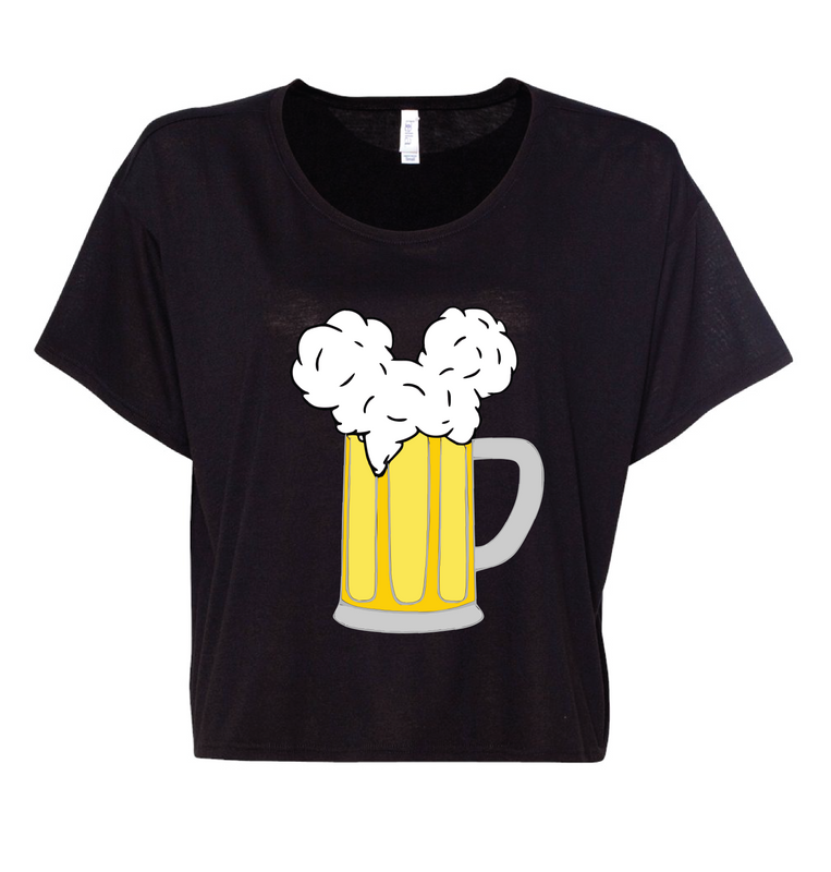 Summer is heating up but you don't have to! OUr new boxy, flowy tops are slightly cropped and lightweight to make sure that you aren't too hot in the parks! Black is probably our most popular color and even though you aren't supposed to wear black in summer, we respectfully disagree with that statement. Grab your Mouse Ears and your Cold Beers and stay cool all summer long.