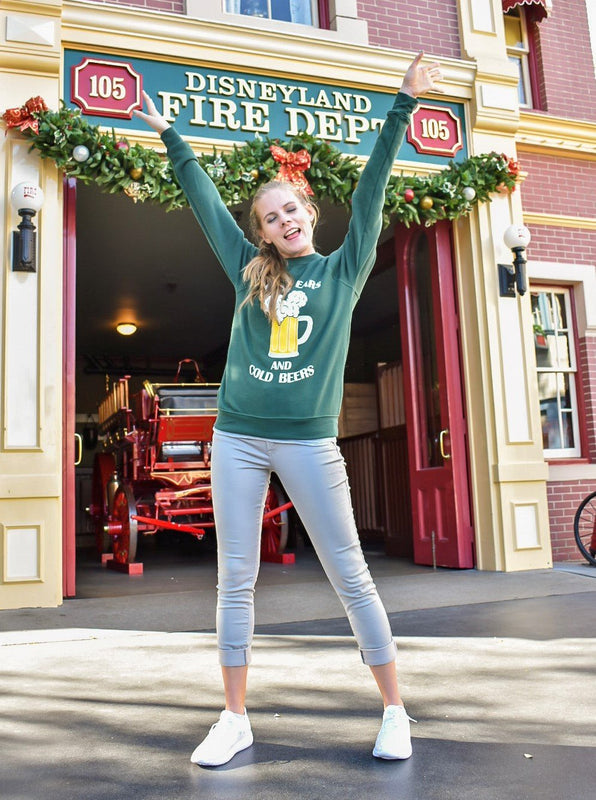Out celebrating Christmas at Disneyland in front of the Fire Department station in this super comfortable and soft Mouse Ears and Cold Beers fleece sweatshirt in hunter green.