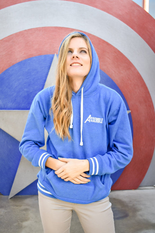 "The Walk It Off hoodie has a front pouch and a hood. The front says ""Assemble"", with the A being the iconic Avengers symbol."