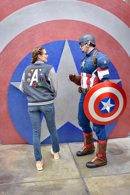 Donna from Brand By You shows Captain America her Assemble the Avengers letterman jacket. She met Captain America in Hollywood Land in the back lot of California Adventure. Her jacket was the perfect conversation starter for this character meet and greet.