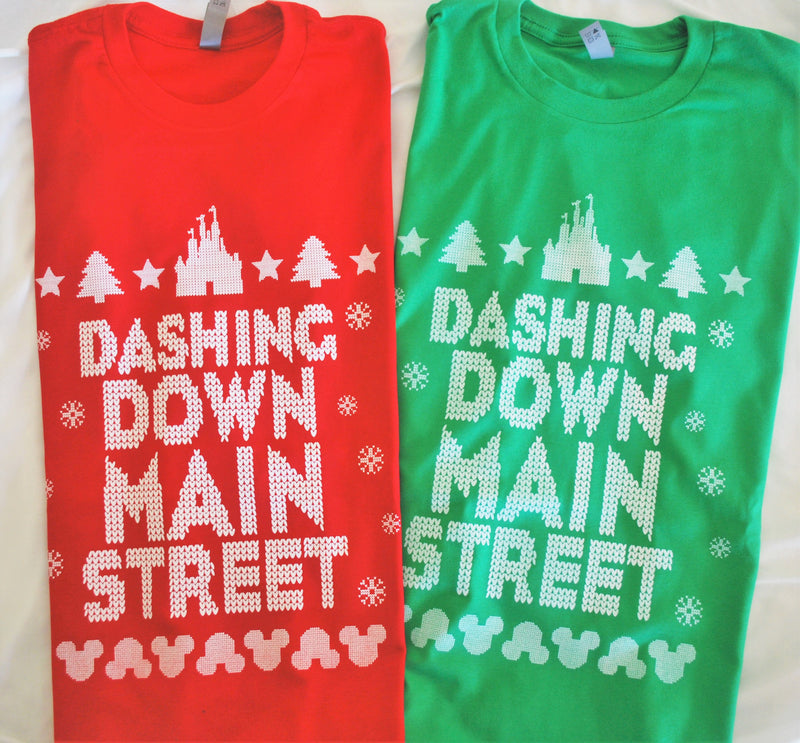 Dashing Down Main Street USA features an ugly sweater type of stitching on this unisex crew neck - available in all your favorite Christmas colors: red, white, and green. The top of the design features a castle silhouette, Christmas trees, and stars. The bottom features mouse heads in corresponding up and down sequence. The design looks as though it was stitched directly into the garment.