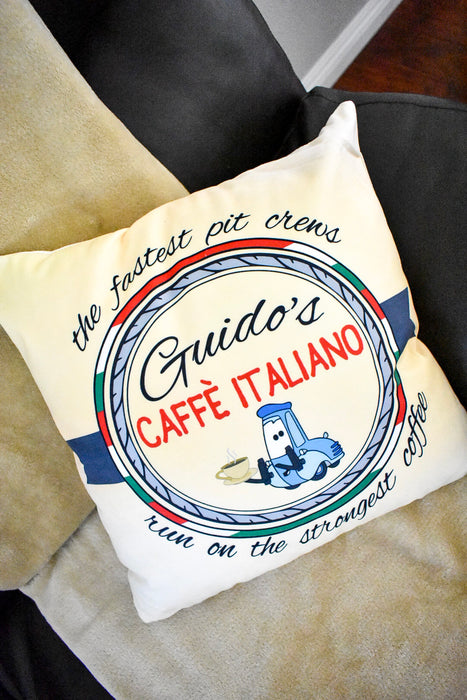 Another look at Guido's Caffe Italiano pillow to show some of the faded and discolored look of it. In this way it gives a great theme to being an aged, rustic, and bold coffee blend.