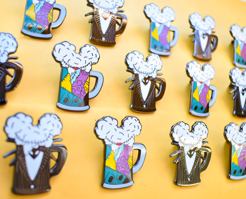 A side view of both the Jack Skellington and Sally Stitches inspired Mouse Ears and Cold Beers character pins.