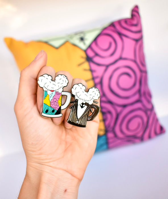 Did I mention that our new Mouse Ears and Cold Beers character pins match our newly restocked Jack and Sally two sided plush pillow? Time to get your haunt on!
