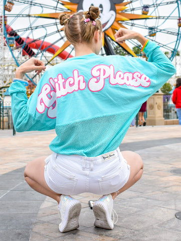 The newest Spirit Jersey of Spring and Summer 2019 is now available at Brand By You - mesh! This mesh Spirit Jersey is inspired by everyone's favorite glitch, Vanellope, from Wreck It Ralph. It features a candy embellishment on the front and says Glitch Please on the back for full sass!