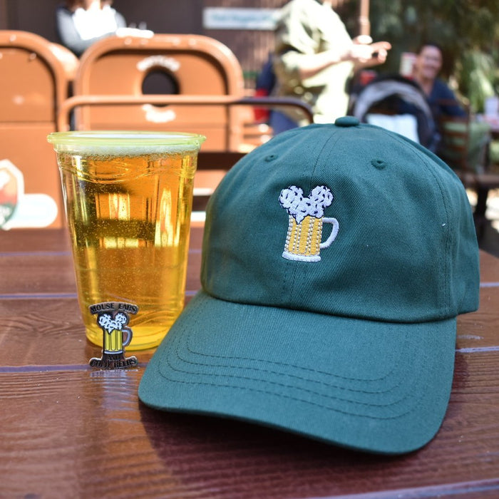 Mouse Ears and Cold Beers is Brand By You's trademarked design. Here we see the popular pin as well as one of our favorite dad hats. Joined lastly with a California Adventure, ice cold beer to round out the team! We have many styles to wear this design, don't be caught drinking without at least one of them!