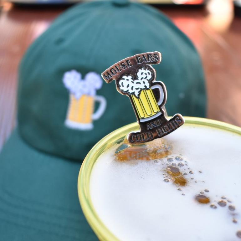 Brand By You is the home to Mouse Ears and Cold Beers (trademarked!). Show your love for Mickey and alcoholic beverages with this hard enamel pin. It features everything you love about our best selling design in a perfect pin collecting manner