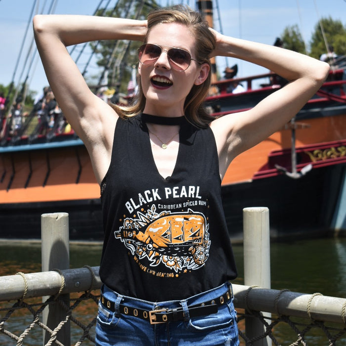 Aboard the pirate ship docked at Disneyland, we crave Caribbean Spiced Rum like our favorite pirates would. This cut-neck tank that features a choker neckline features our Black Pearl Caribbean Spiced Rum design in an orange ink for a Halloween twist!