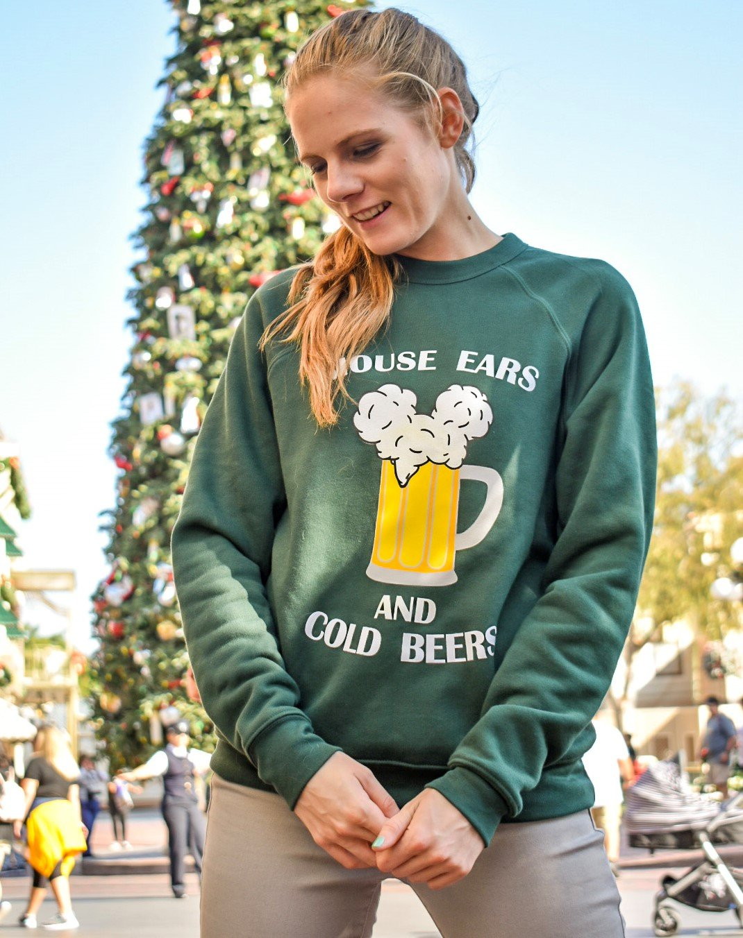 Enjoy mouse ears and cold beers on Main Street USA at Disney with the Christmas tree. This fleece sweatshirt will keep you warm this winter!
