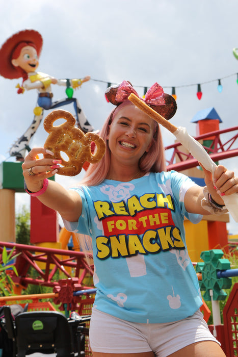 Rachel from Disney Princess Couture definitely reached for ALL of the snacks during her time in Toy Story Land. And rightfully so because her amazing shirt featured so many tasty Disney snacks that it was so hard not to snack on all the things Disney had to offer! Reach for the Snack sublimated tee is a unisex fit, lightweight, and comfortable! It is the perfect fit for anyone looking for a great tee for the parks!