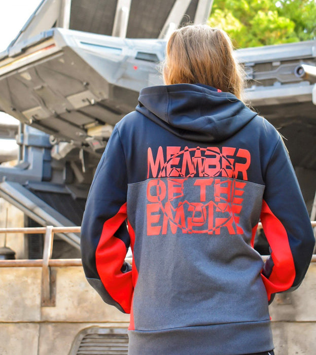 Member of the Empire black and red colorblock hooded jacket with a front pouch. Picture taken in front of an Empire starship in Galaxy's Edge.