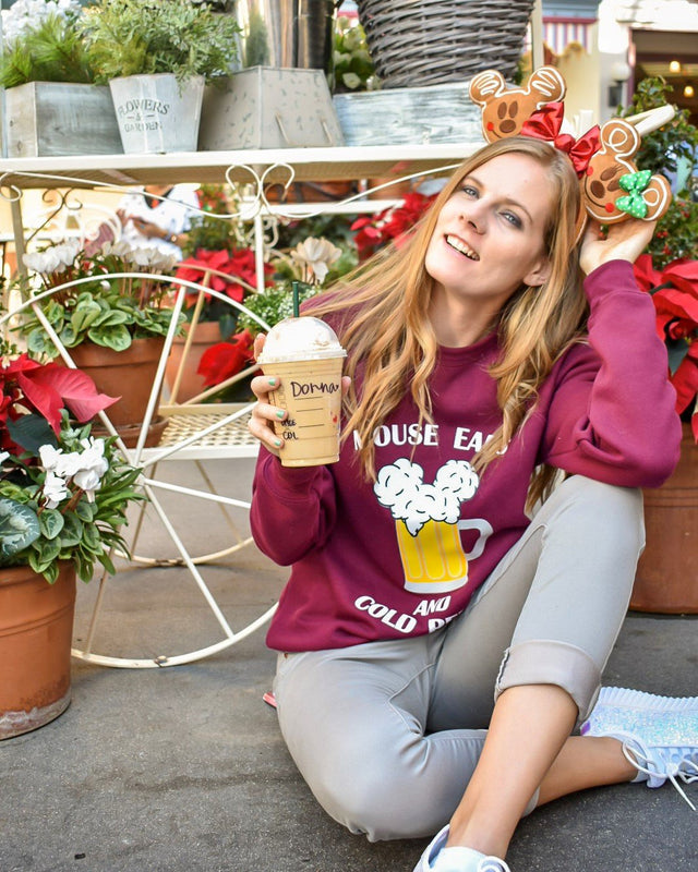 The Christmas decorations at Disneyland are always so on point. In fact, the flower cart outside of Starbucks happens to be the perfect place to take pictures of this new Mouse Ears and Cold Beers unisex sweatshirt in garnet!