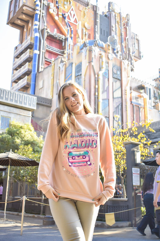 Stay warm this winter after you break out of Tivan's Collection with this Guardians Radio sweatshirt! It perfectly matches the outside of the Mission Breakout ride!
