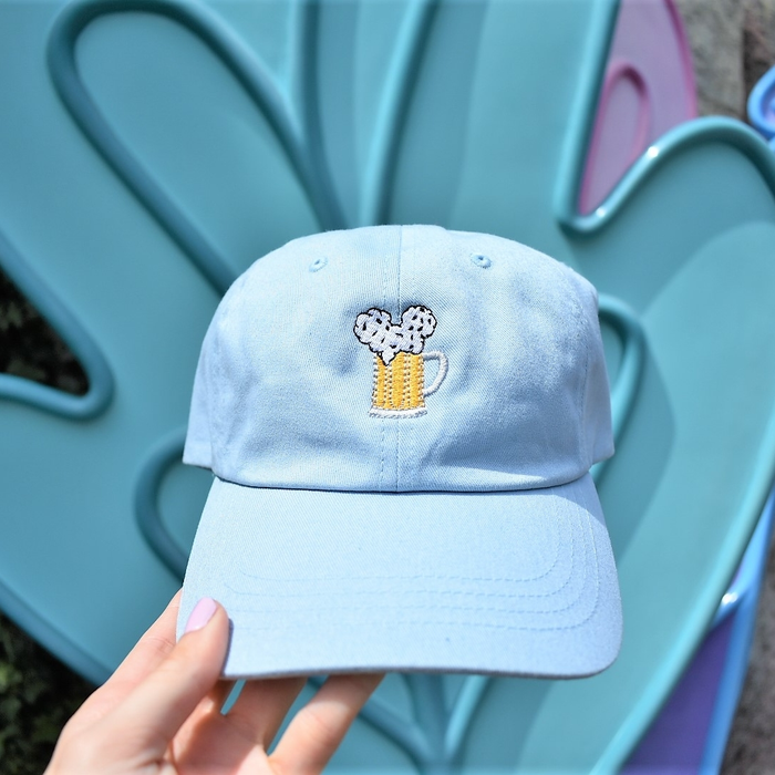 If you are planning on wandering around Wonderland this summer, we have the perfect dad hat for you. If you loved our Mouse Ears and Cold Beers design already, then you are sure to spill your tea and grab a beer after you see this light blue hat. This hat is the perfect addition to your summer look by adding a pop of color to your outfit while at the same time complimenting your love for all mouse ears and cold beers things.