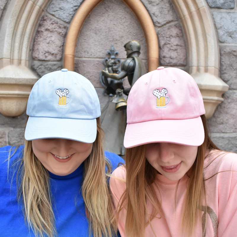 Whether you are making it blue or making it pink, Brand By You has both options for you this summer. With out iconic Mouse Ears and Cold Beers design on these dad hats, you will be so hot keeping it cool. This design has been called one of the best designs for showing your love for all things magic and all things beer while wandering the Disney parks. We have colors available, suited for both men and women who love our Mouse Ears and Cold Beers design.