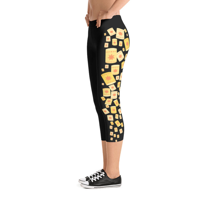 These leggings convey the perfect abundance of floating lanterns up and down the side of both of the pant legs. These Tangled themed leggings are the perfect addition to any lover of best days ever and Rapunzel herself! This particular style features the lanterns on a black background in a capri pant style.